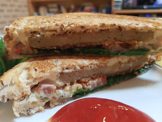 Vegie Delights Classic Not Burger toastie with sesame cheese, spinach, tomato
