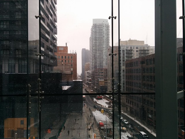 Seen looking east from the Yonge-Eglinton Centre patio #toronto #yongeandeglinton #yongeeglintoncentre #patio #spring #snow #eglintonavenue #eglintoncrosstown #cranes #skyline #glass