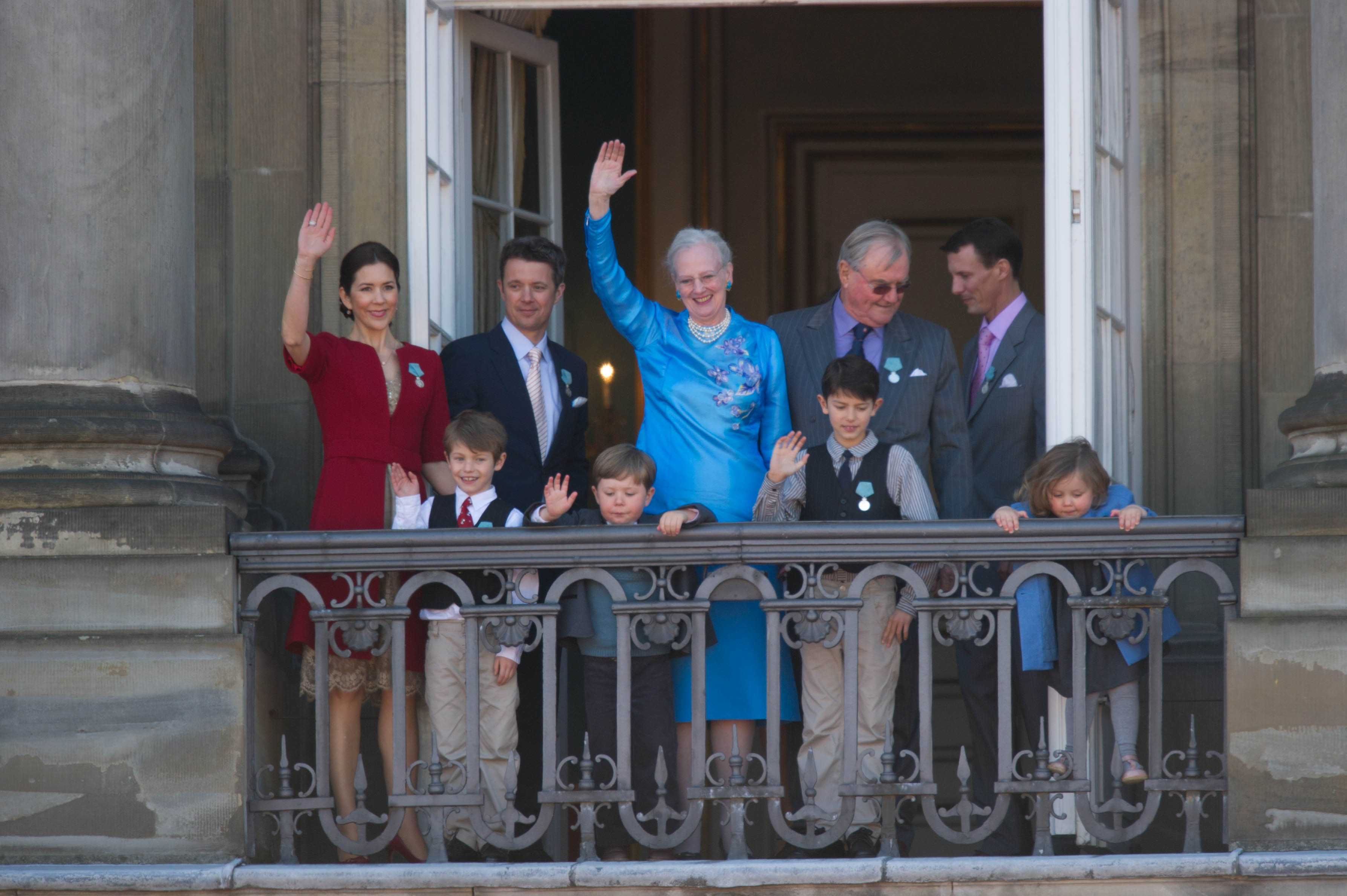 The Queen surrounded by her family waving to crowds on her 70th birthday pn April 16, 2010. From left to right: the Crown Princess, Prince Felix, the Crown Prince, Prince Christian, the Queen, Prince Nikolai, Prince Consort Henrik, Prince Joachim and Princess Isabella.