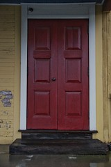 The red door on the yellow house