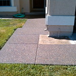 Plum creek exposed aggregate front walkway.