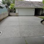 Salt & pepper exposed aggregate driveway.